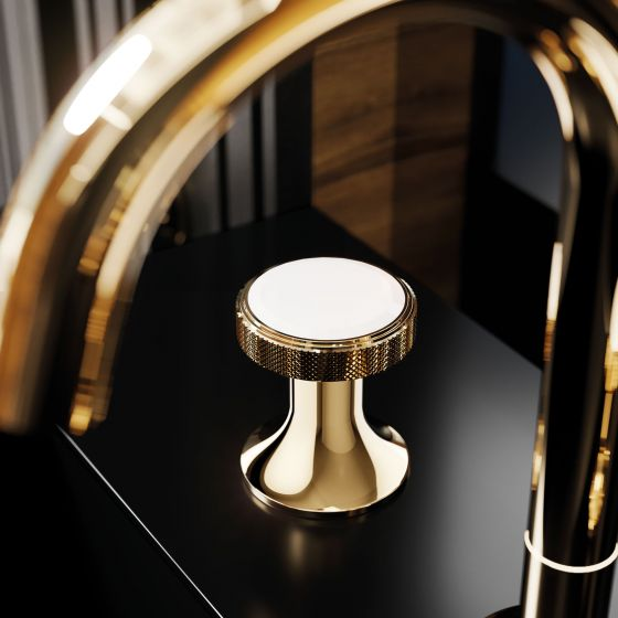 Close-up of the Valencia washbasin tap by Jörger in the exclusive finish sunshine with white crystal on a black background.