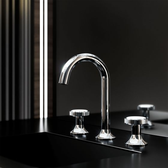 "JÖRGER Design – Glamourous new look for ""Valencia"": The elegant fitting for the washbasin shines in the exclusive finish ""chrome"". Together with black surfaces an elegant dream. The tap handles are decorated with precious white crystals."