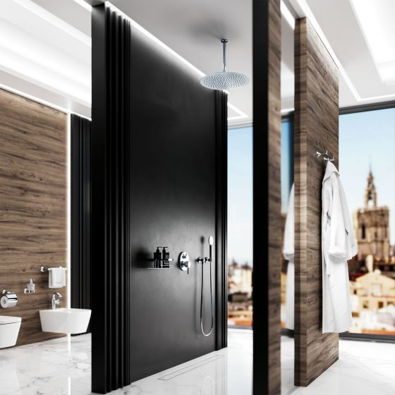"Modern luxurious bathroom equipment with walls of matt black stone, decoratively grained wooden panels and fittings and accessories in the finish chrome from Jörger's ""Valencia"" design series."