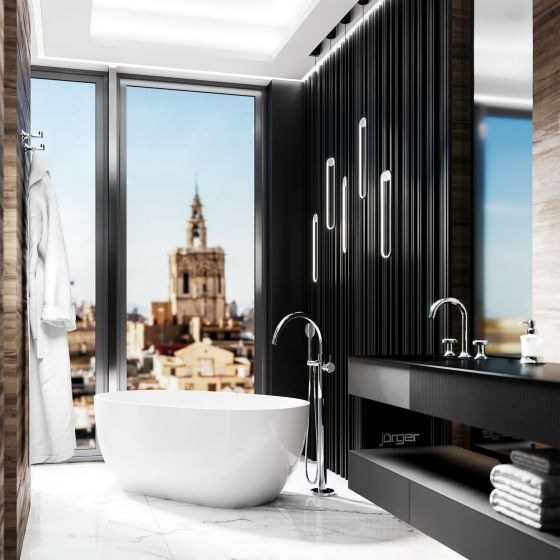 Valencia in the finish chrome design by Jörger in a modern bathroom interior: the free-standing bath fitting, the washbasin tap and accessories shine in tasteful surroundings.